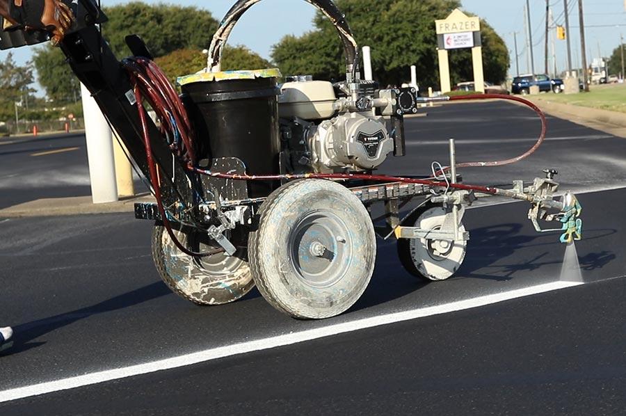 spraying parking lot lines